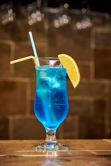 Cold blue cocktail with lemon.
