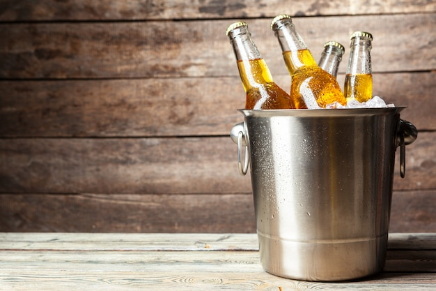 Cold bottles of beer in the bucket