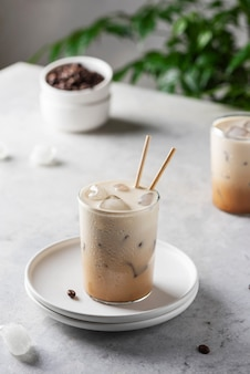 Cold coffee with ice and cream, selective focus image
