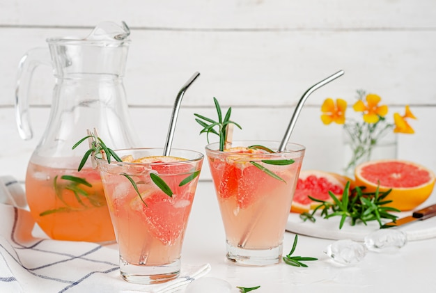 Cold detox cocktail of grepefruit and rosemary. healthy drinking. copy space