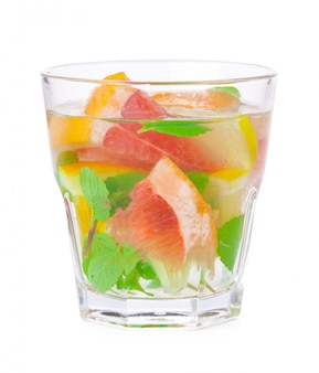 Cold drink with different citrus and herbs in glasses. cocktail