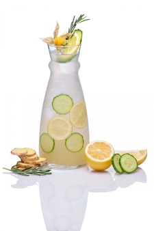 Cold drink with ginger, cucumber, lime, rosemary and physalis