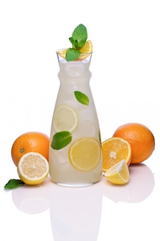 Cold drink with orange, lime and pepper mint