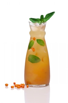 Cold drink with sea buckthorn and mint