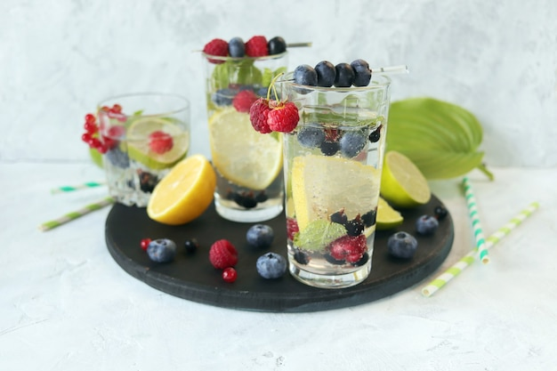 Cold drinks from citrus raspberry and blueberry mint leaves and mineral water healthy lifestyle