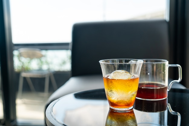 Cold drip arabica black coffee in glass with ice ball