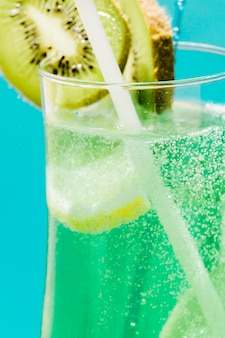 Cold exotic green summer cocktail with kiwi and lemon