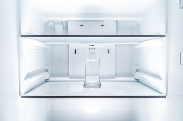 Cold glass of water in clean refridgerator