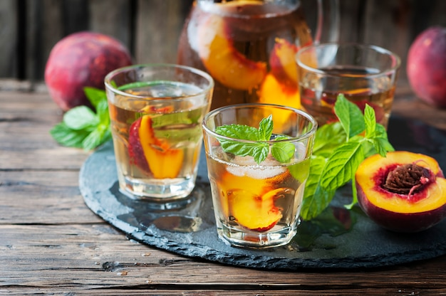 Cold healthy tea with peaches and mint