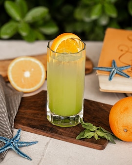 Cold lemon cocktail with orange slice
