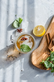 Cold lemon green tea in glass with anise ice. heathy summer probiotic drink