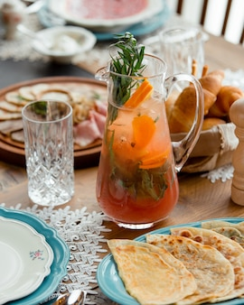 Cold lemonade with fruits and herbs