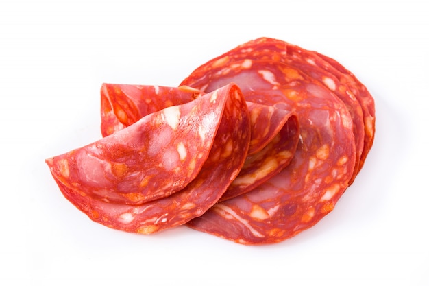 Cold meat chorizo slices on white surface