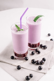 Cold milkshake with a black currant