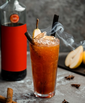 Cold pear drink with cinnamon sticks