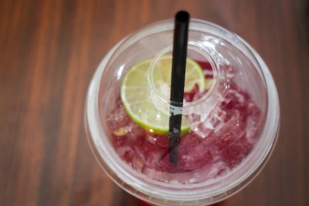 Cold red drink with lime slice