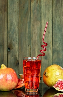Cold ruby juice in glass and straw