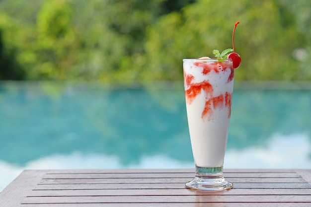 Cold smoothies drink on vacation at the swimming pool.copy space
