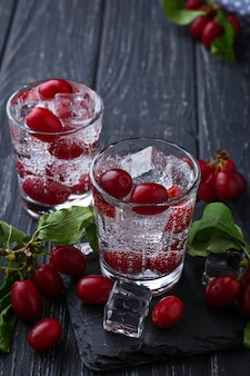 Cold summer drink with red berries. selective focus