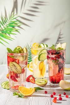Cold summer fruit lemonade drinks, refreshment infused water. summer drinks with ice.
