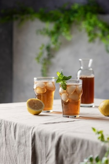 Cold summer tea with lemon and mint,