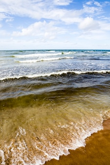 Cold summer weather on the baltic sea with lots of waves from strong winds, the baltic sea is cold in the summer