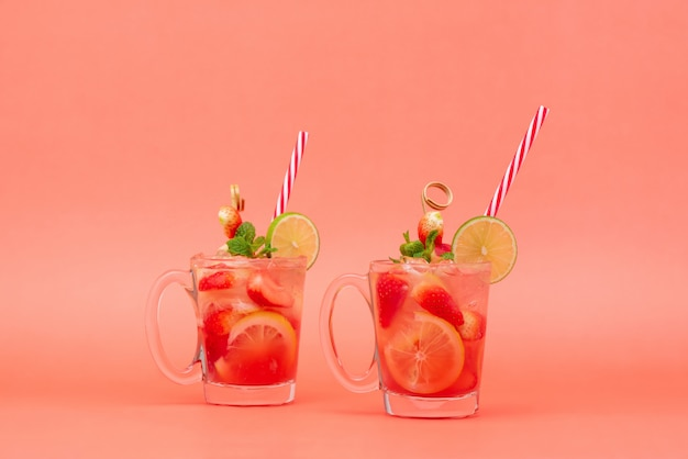 Cold sweet and sour strawberry lemonade juice drinks in the glasses