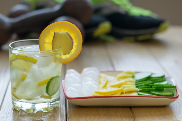 Cold water with lemon, ginger, orange and cucumber.