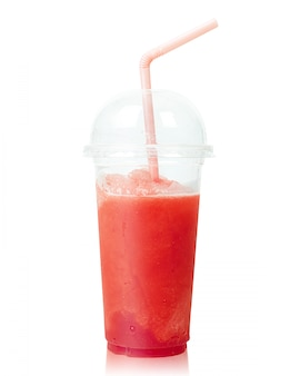 Cold watermelon smoothie in plastic cup with straws isolated on white.