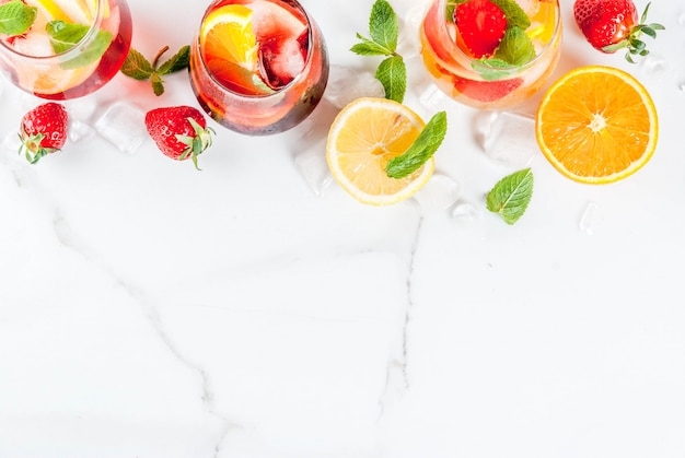 Cold white, pink and red sangria cocktails