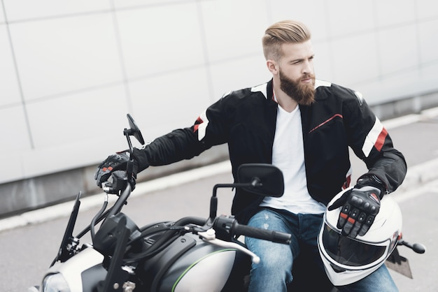Collage brutal male biker sitting on motorcycle