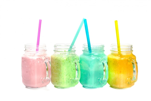 Collage of glass jars with fresh delicious smoothie and straw