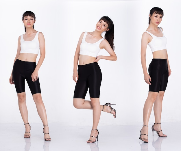 コラージュグループ20代のアジア人女性のフルレングスの肖像画黒髪白の広大なパンツとハイヒールの靴。女の子は白い背景の分離の上に強い背の高いルックスをポーズします