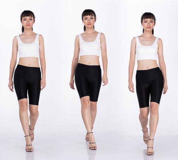 コラージュグループ20代のアジア人女性のフルレングスの肖像画黒髪白の広大なパンツとハイヒールの靴。女の子は前方に歩き、サイドステップビューは白い背景を分離します