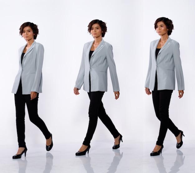 コラージュグループ20代のアジア人女性のフルレングスの肖像画黒のショートカールヘアグレーのスーツジャケットパンツと靴。女の子は左のビューを歩く白い背景の多くの外観が分離されました