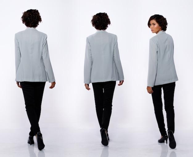 コラージュグループ20代のアジア人女性のフルレングスの肖像画黒のショートカールヘアグレーのスーツジャケットパンツと靴。少女の散歩は、白い背景を分離した多くの外観を後ろ向きに表示します