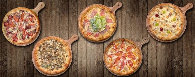 木の板に5種類のピザのコラージュ