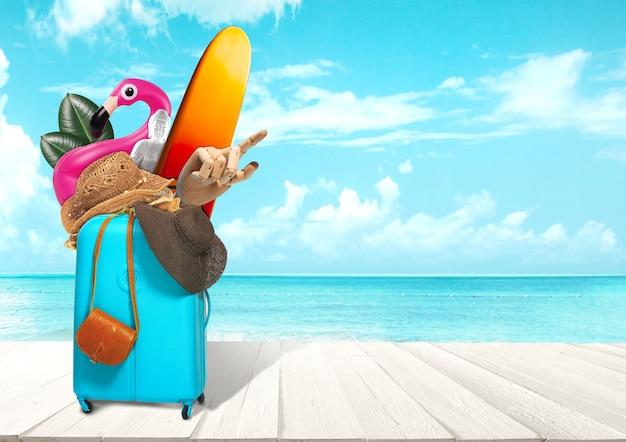 Коллаж багажа для путешествий перед видом на океан. концепция лета, курорта, путешествия, поездки, путешествия. нужные вещи. доска для серфинга, резиновое кольцо в виде фламинго, шляпа, рука робота, статуя будды