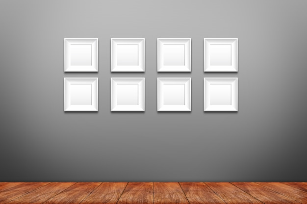Collage of white photo frames on the wall