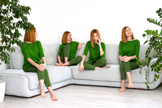 Collage young beautiful red haired girl in green clothes at home with house plants in a different mood and a variety of emotions.