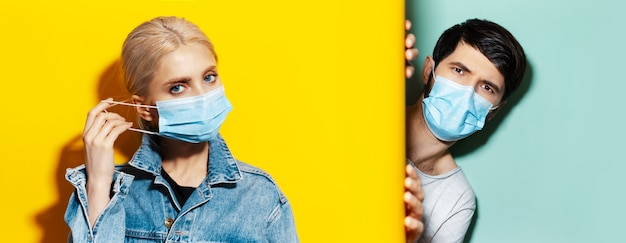Collage of young guy and girl wearing medical face mask against coronavirus on two backdrops of yellow and aqua menthe colors.