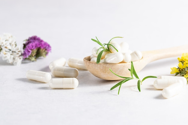 Collagen capsules for skin and beauty in the wooden spoon