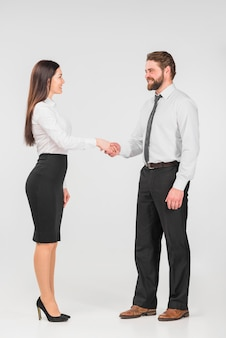 Colleagues female and male shaking hands