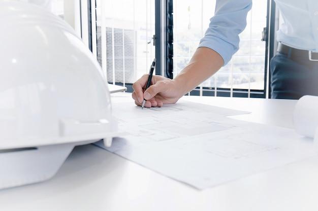 Colleagues interior designer corporate achievement planning design on blueprint teamwork concept with compasses.