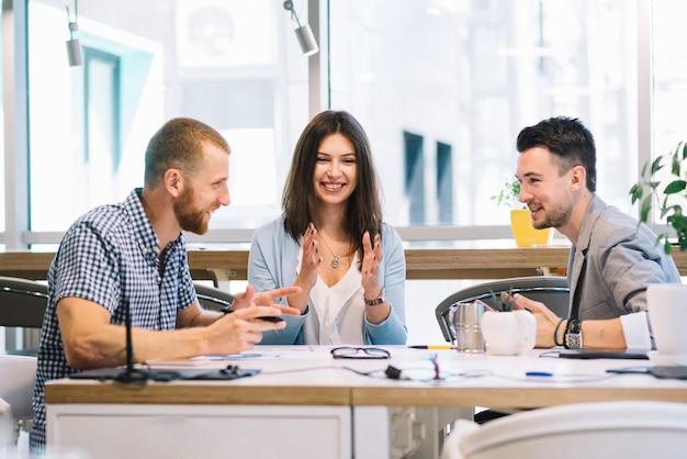 Colleagues speaking during break