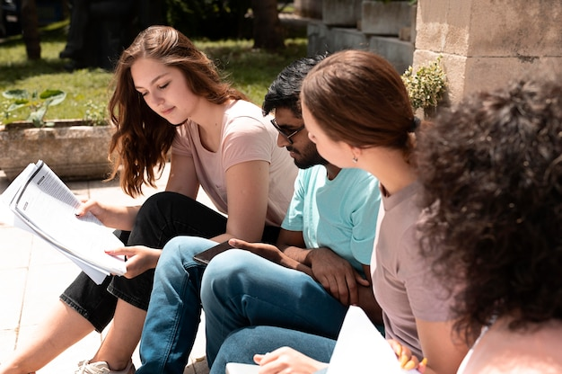Colleagues studying together in front of their college before an exam