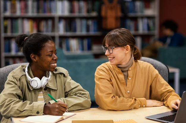 Colleagues studying in the university library