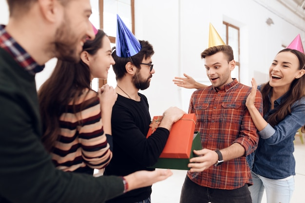 Colleagues surprise another employee of company