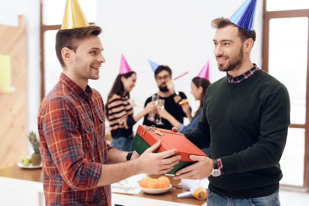 Colleagues surprise another employee of company.