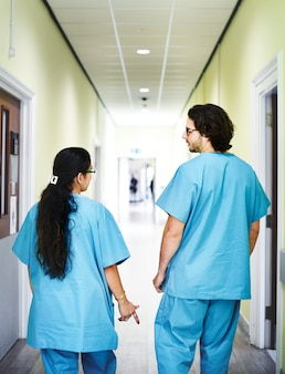Colleagues walking down the hospital corridor
